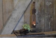 Houten ornament met ijzeren lepel